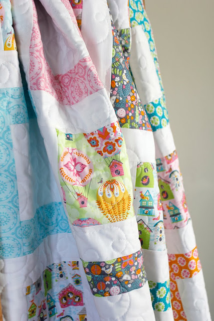 Cute throw quilt called Framed Squares - a free quilt pattern from A Bright Corner