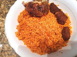 Jellof rice served with Roasted Chicken and  fried beef