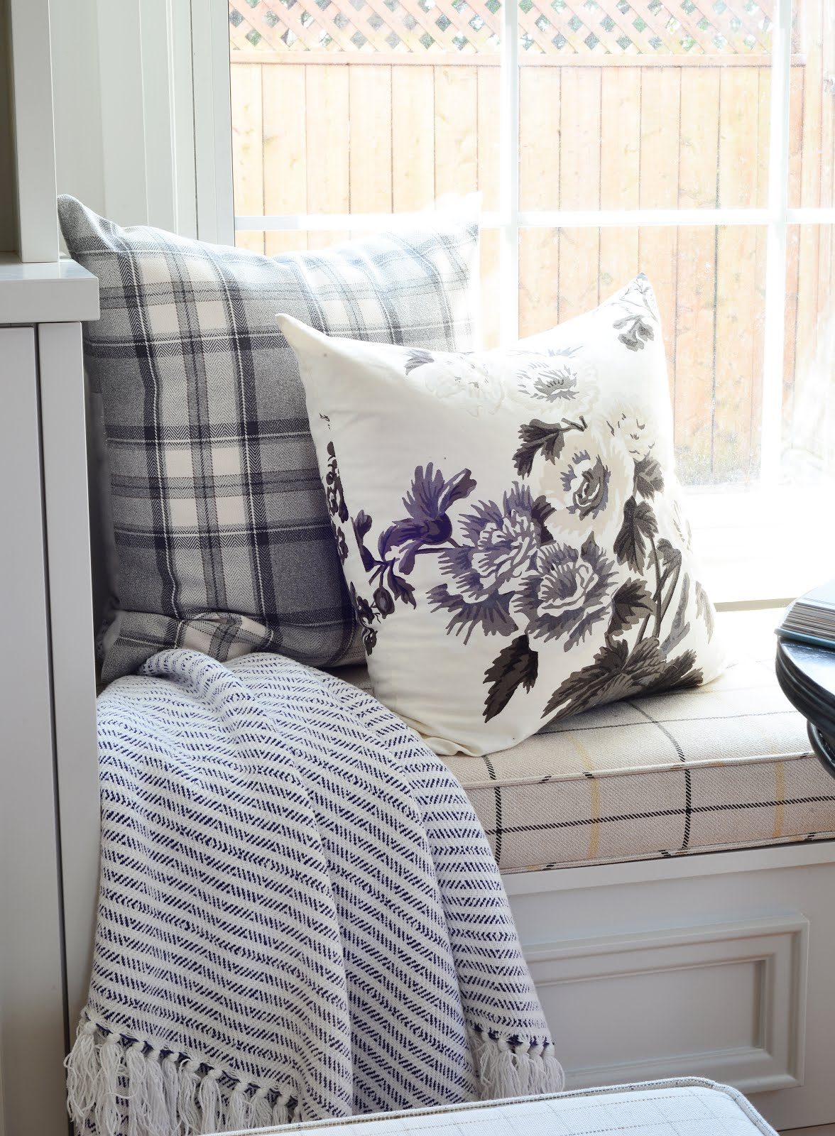 cozy window bench seat, floral pillow cover, striped throw, plaid cushion covers