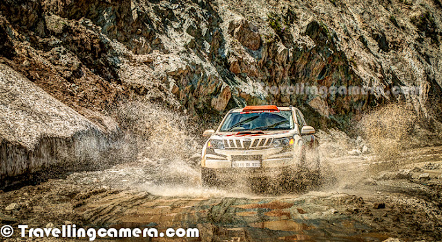 Mahindra XUV500 in 3rd Mughal Rally 2012 at Shrinagar, Jammu & Kashmir, India || Mahindra Adventure Participants in a Motorsport event by Himalayan Motorsports - by VJ Sharma at www.travellingcamera.com  Motorsport events also provide a good platform for Automobile Companies to promote their new models or brand through passionate folks. Personally I liked the branding of Mahindra on XUV500 and design/color was looking brilliant on this wonderful machine. This Photo Journey shares few more photographs of Mahindra XUM500 in action along with some information about Mahindra's contribution towards Motorsports in India..Mahindra has a unit called 'Mahindra Aventure' which mainly focuses on Off-road events. This is a dedicated unit of organization for efficient execution on this front.In their own words - 'From Leh to Kottayam and Nashik to Kohima, we have been perfecting the art of 'Getting Lost'. With over 35 events last year alone, Mahindra Adventure is the perfect platform for driving enthusiasts to explore our beautiful country. From a day long great escape to multi-day expeditions and supporting incredible endeavors by privateers; Mahindra Adventure has done it all. Professionally maintained fleet of Mahindra vehicles, FMSCI approved event organizers across the country, precise execution that matches the motorsport standards and a personal touch makes Mahindra Adventure very unique. If you are part of an event organized by Mahindra Adventure, you can be rest assured that you will be taken care of in all possible manners. Don't believe us? Please do visit our social communities to know about the experience of our participants last year. Mahindra Adventure has taken it to the next level by offering off-road championship, TSD championship and an international event.'(Courtesy - www.mahindraadventure.com/about-us.html)Mahindra Cars were really looking differents in 3rd Mughal Rally as their designing was apt and very effective form branding point of view. Whole credits go to the person or company who has done this branding for Mahindra. Another distinguishable team at Mughal Rally was TATA Fullthrottle Team, although branding was not that impressive. We shall be sharing another Photo Journey with different TATA cars, SUVs etc. My personal pick was TATA XENON from their side :) ... RED Xenon was really rocking the hills around Mughal Road in Jammu & Kashmir State of India.Above photograph shows the real action of Mughal Rally and Motorsports in Hilly terrains of India. Mahindra XUV has been amazing while running on these narrow roads of Sinthan Pass in Jammu & Kashmir. To know more about Mahindra Adventure, check out - http://www.mahindraadventure.com/
