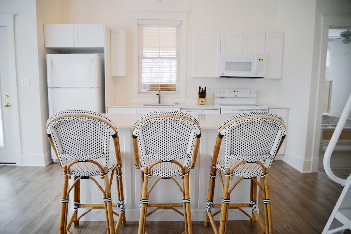 white cottage kitchen | Serena & Lily black white Riviera french bistro counter stool