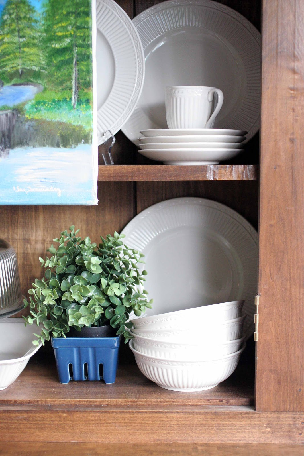 http://craftivitydesigns.blogspot.com/2013/01/white-dishes-wood-hutch-organized-and.html