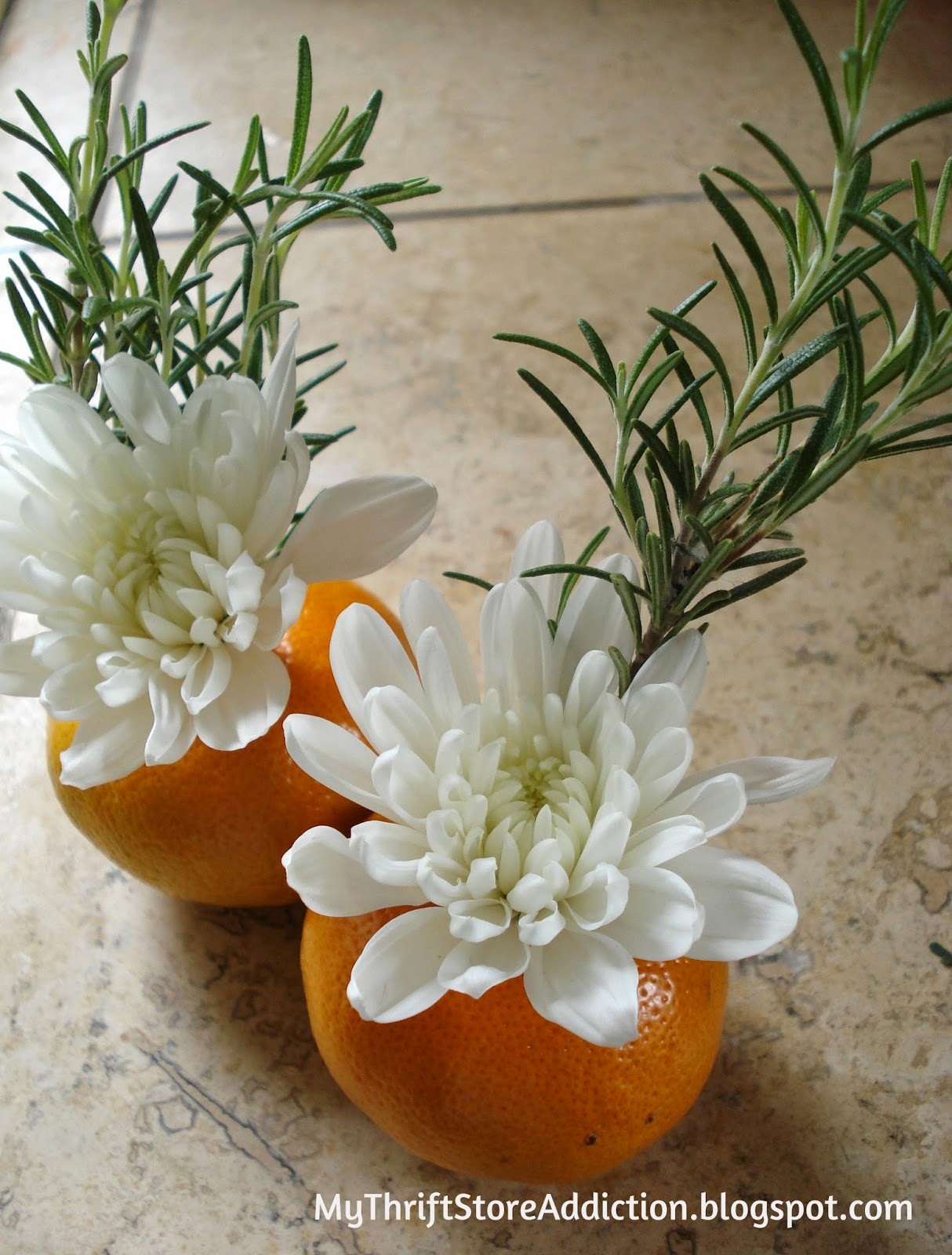 Fresh herb, flower and orange bouquets