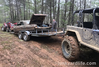 A modified Jeep TJ with a Chevy LS-6.0 pulls the 1963 Impala home.