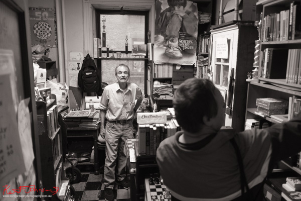 Fred Wilson and a customer at Fred Wilson books NYC. Photographed by Kent Johnson for Street Fashion Sydney NY Edition.
