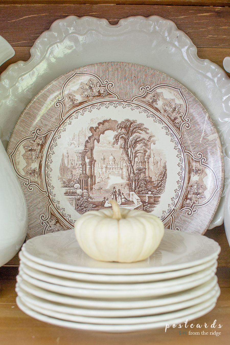 brown transferware plate and baby boo pumpkin