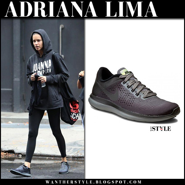 Adriana Lima in black hoodie, black leggings and dark grey black sneakers nike flex model workout fashion november 7 2017