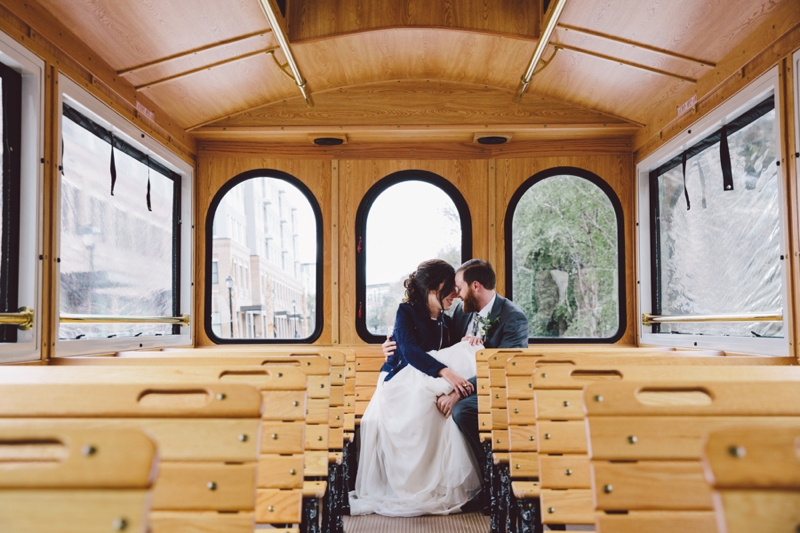 bride and groom in trolley in savannah wedding