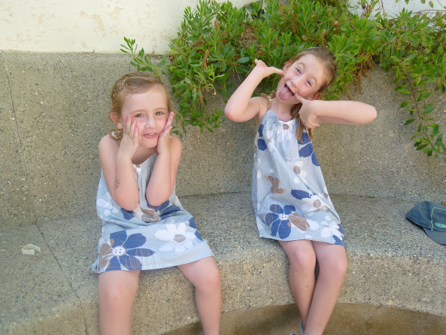 Stephs two girls pulling faces in Spain