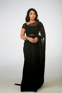 Samvrutha Sunil in lovely Transparent Black Saree and Backless Choli