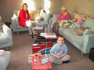 excited boy wil xmas presents to open