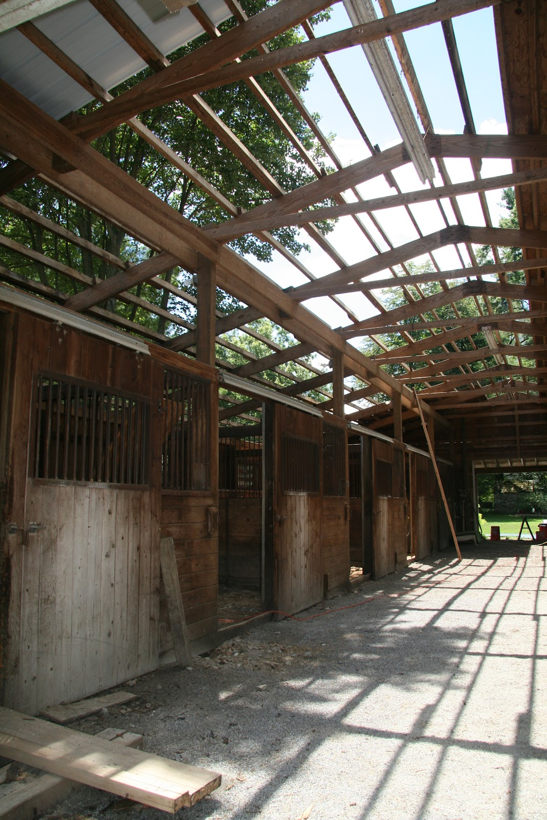 An Old Farm Installing A Ribbed Metal Roof