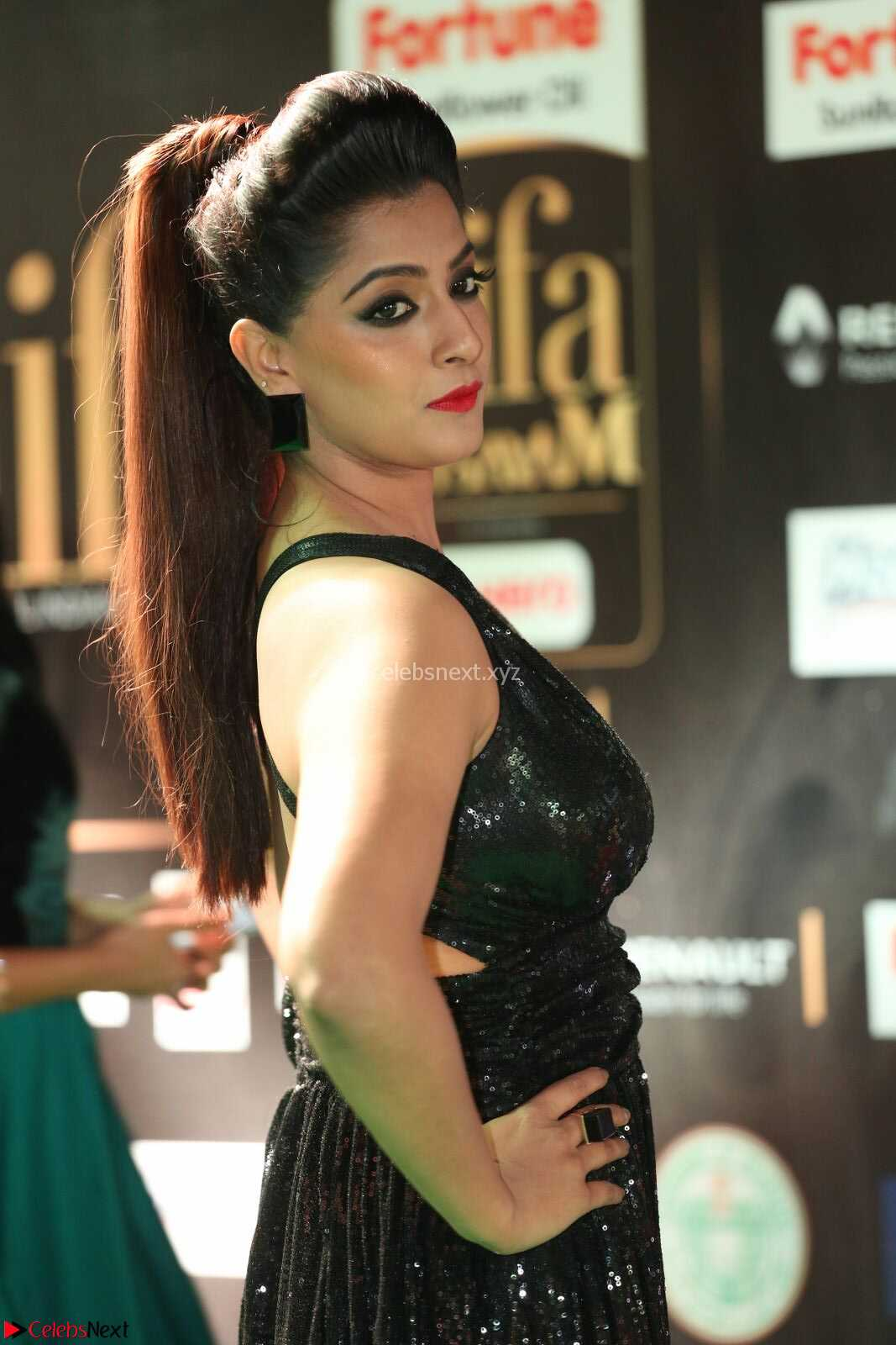 Varalaksmi in Green Glittering Sleeveless Backless Gown at IIFA Utsavam Awards 2017  Day 2 CelebsNext Exclusive