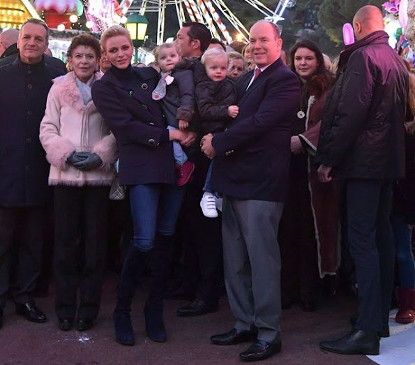 Princess Charlene, Princess Gabriella at opening the Monaco Christmas Village in Monaco. Style of Princess Charlene