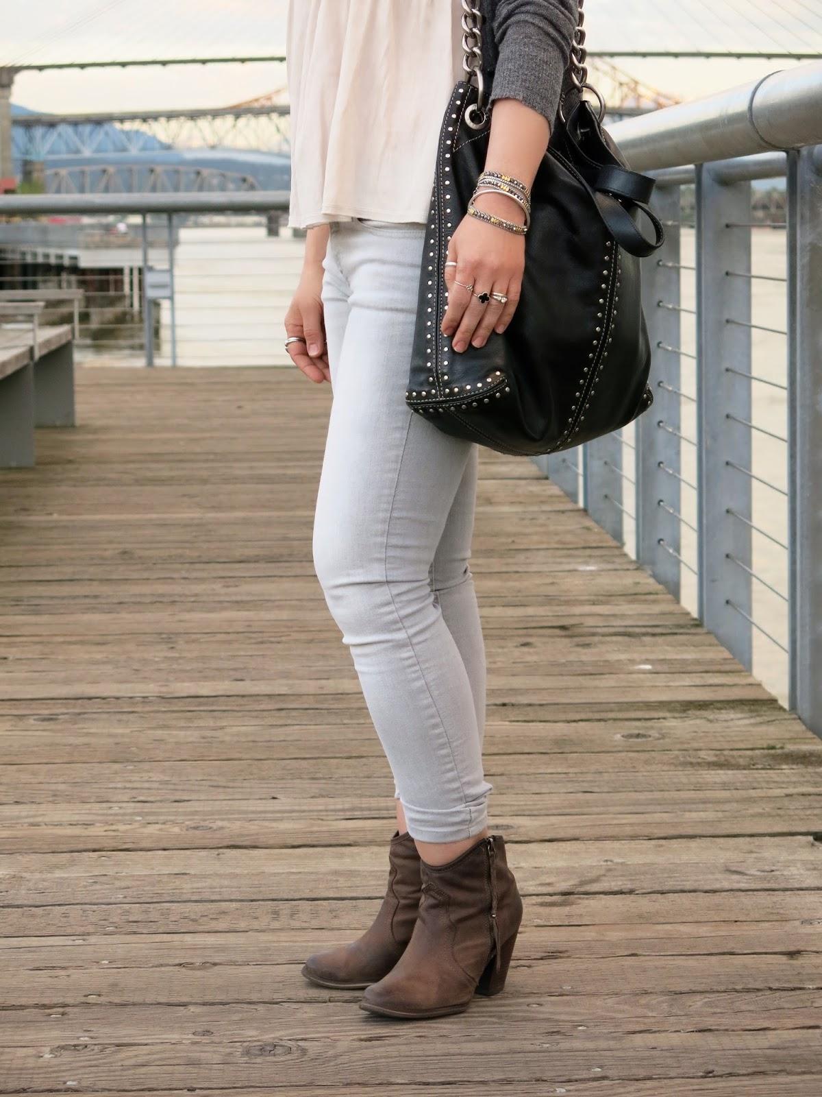 drapey top, skinny jeans, western-style booties, MK bag
