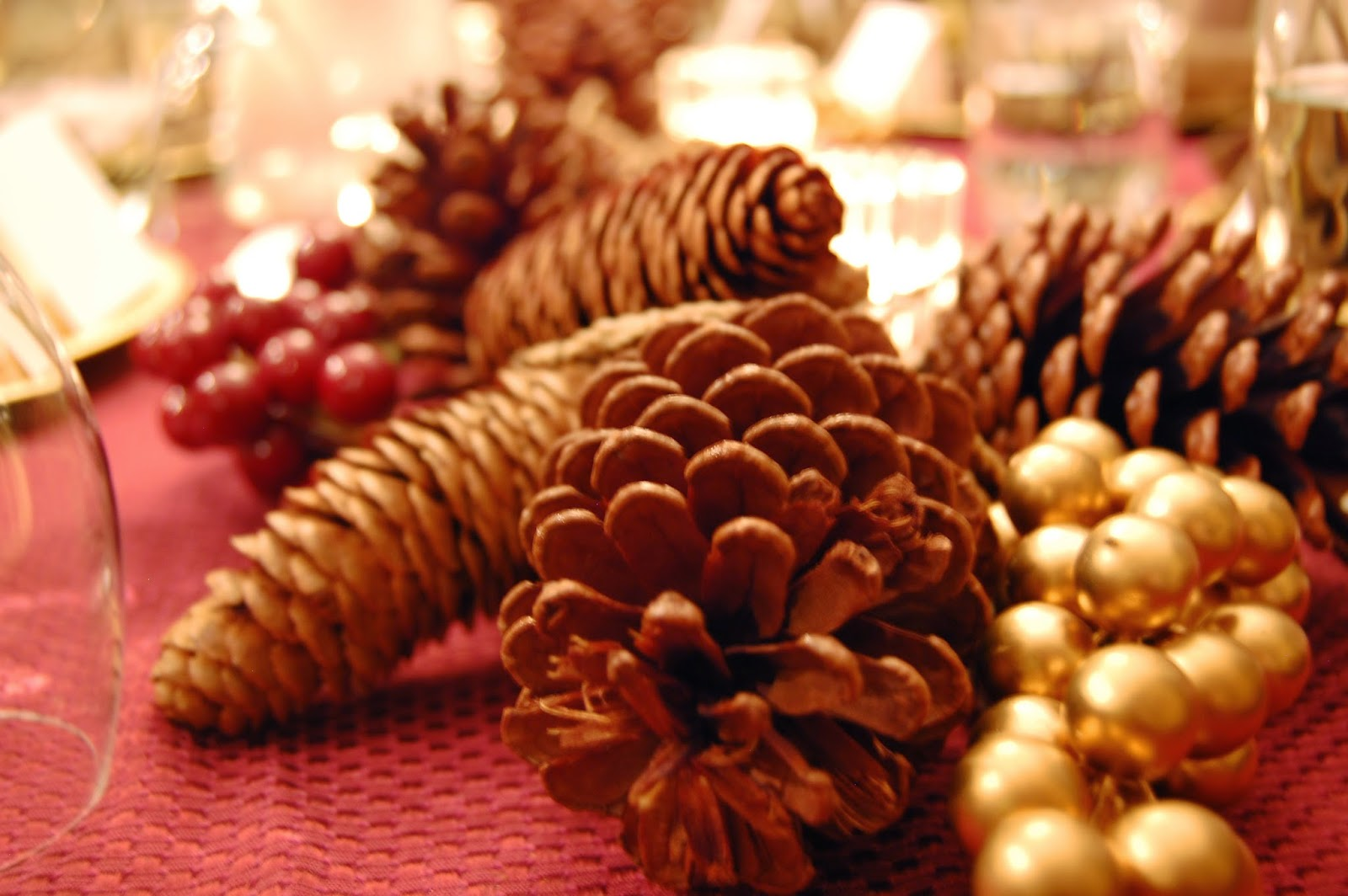 pine cones berry picks holidays white votive candles garland budget decorating design tips table setting arrangement