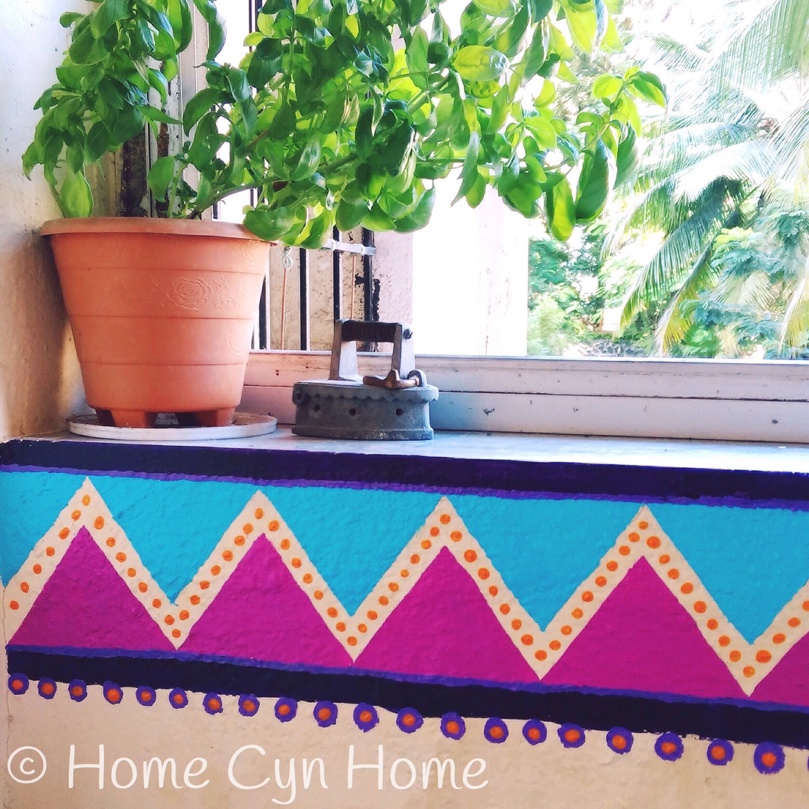 A hand painted bright colors wall border made with a triangle template. I used artist acrylic paint for the job as it gives a good coverage and once it has dried is waterproof.  and