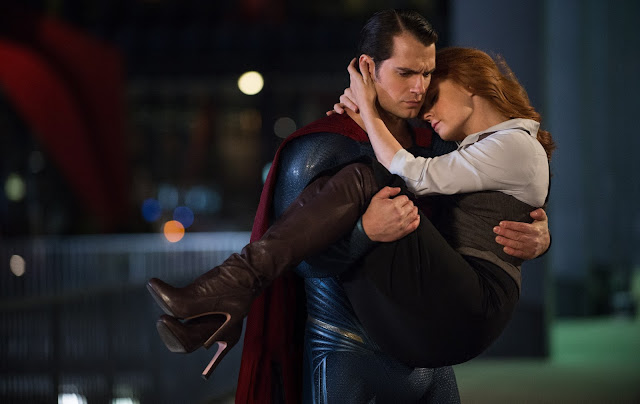 Superman (Henry Cavill) rescues Lois Lane (Amy Adams)