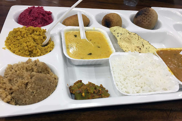 Dal-Bati-Churma at the Rawat Mishthan Bhandar, Jaipur. Three varieties of Churma  rose, besan and plain. Three varieties of bati dry fruits, masala and plain