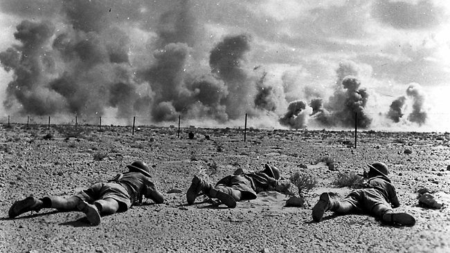 Australian troops crawling along the ground during the Battle of El Alamein in 1942