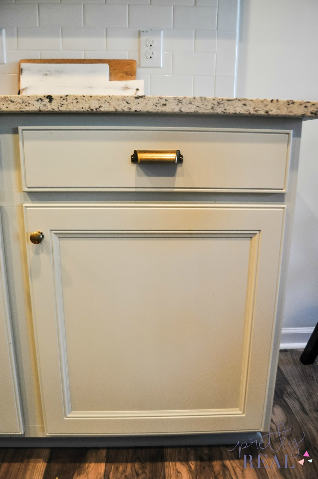 We Painted Our Brand New Kitchen Cabinets And Heres How It Turned - Gray painted kitchen cupboards