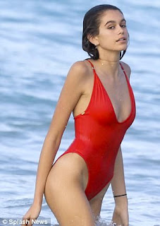 Kaia Gerber wearing red swimsuit in St Barts