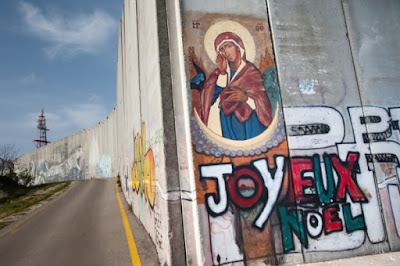 https://www.onfaith.co/onfaith/2014/12/11/photos-activists-hold-mass-at-the-border-blocking-bethlehem/35384