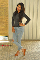 Actress Bhanu Tripathri Pos in Ripped Jeans at Iddari Madhya 18 Movie Pressmeet  0016.JPG