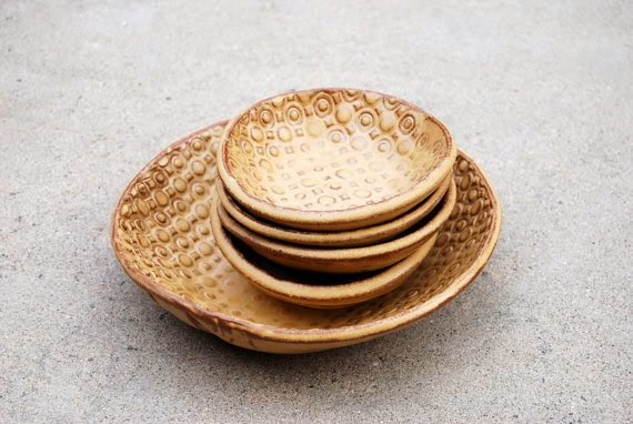 https://www.etsy.com/listing/173365894/ceramic-bowls-set-of-five-in-golden?ref=favs_view_2