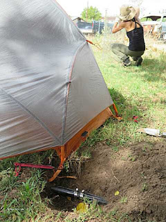 Picture of repaired sprinkler line and tent while bike camping
