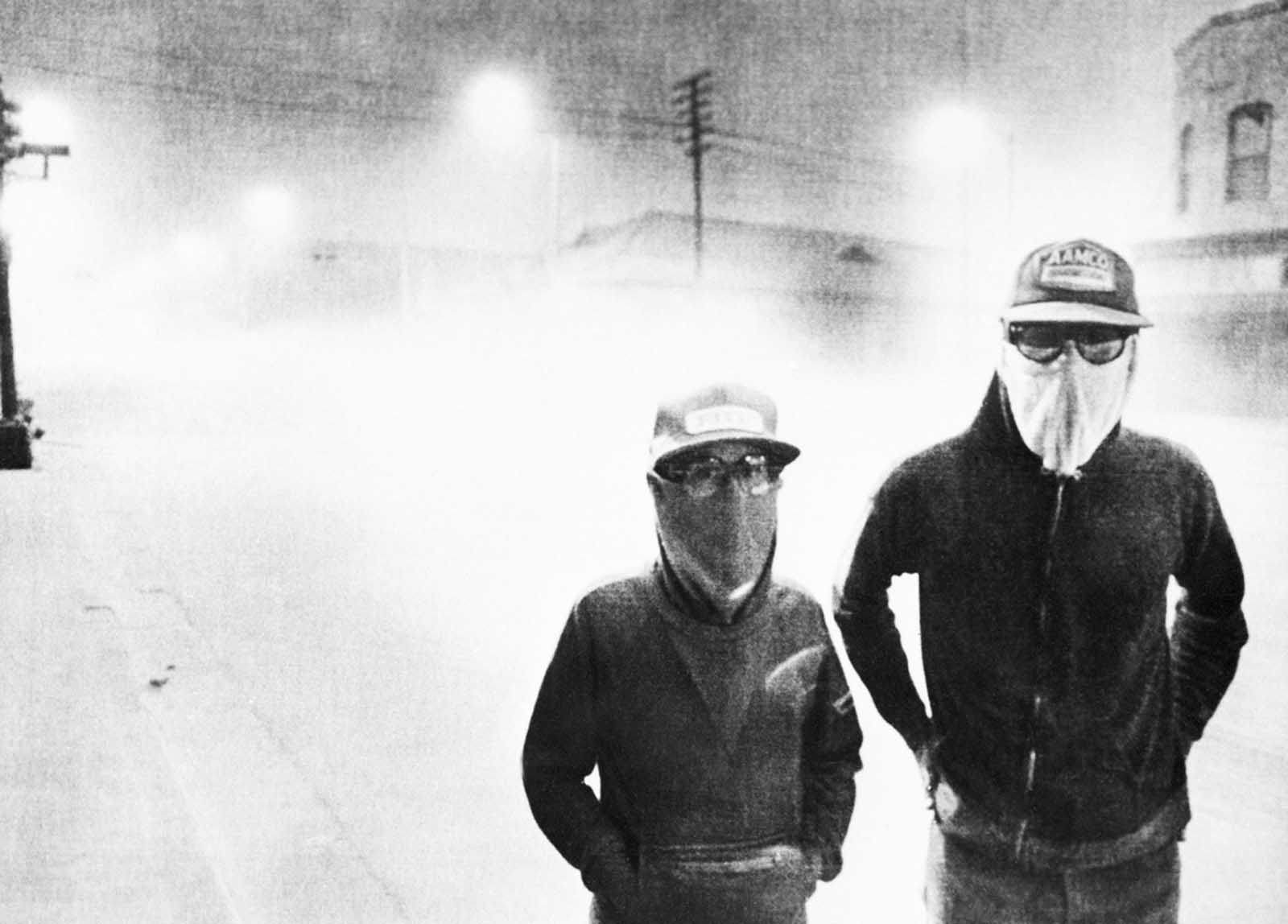 The streets of Yakima, Washington, are dark at 3:00 p.m. after an eruption of Mount St. Helens on May 18, 1980. Volcanic ash covered the streets as people wore masks to avoid breathing the particles.