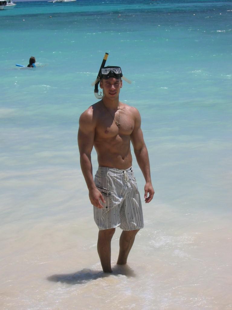beautiful-shirtless-buff-dude-in-blue-ocean-sea