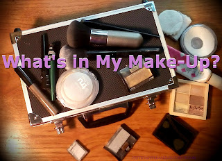 "Bright purple text reading ""What's in my make-up"" over an image of assorted make-up and a black textured case with metal lining."