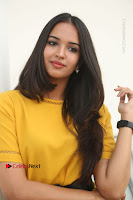Actress Poojitha Stills in Yellow Short Dress at Darshakudu Movie Teaser Launch .COM 0181.JPG