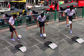Be mesmerized by Bangkok boy's mad toilet paper football skills
