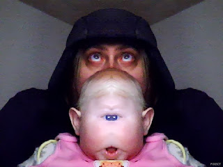 One-eyed baby using webcam