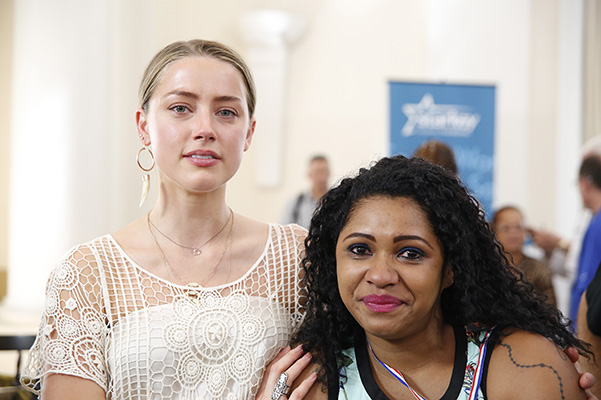 Amber heard broke into tears during a charity event for people with hearing problems