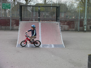 riding a bicycle on skateboard ramp in park