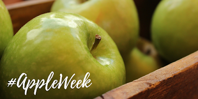 appleweek logo over basket of green apples