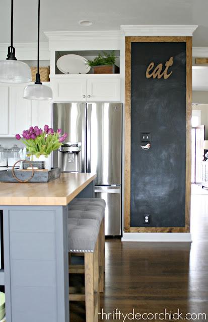 chalkboard in kitchen with wood trim