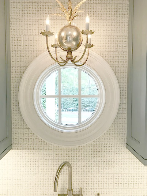 Round window and tile backsplash in blue and white traditional kitchen in Southeastern Designer Showhouse 2017