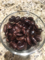 Photo of glass bowl of scarlet runner beans after cooking. https://trimazing.com/