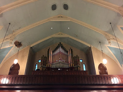 Pipe organ in church mezzanine over entrance to sancturary