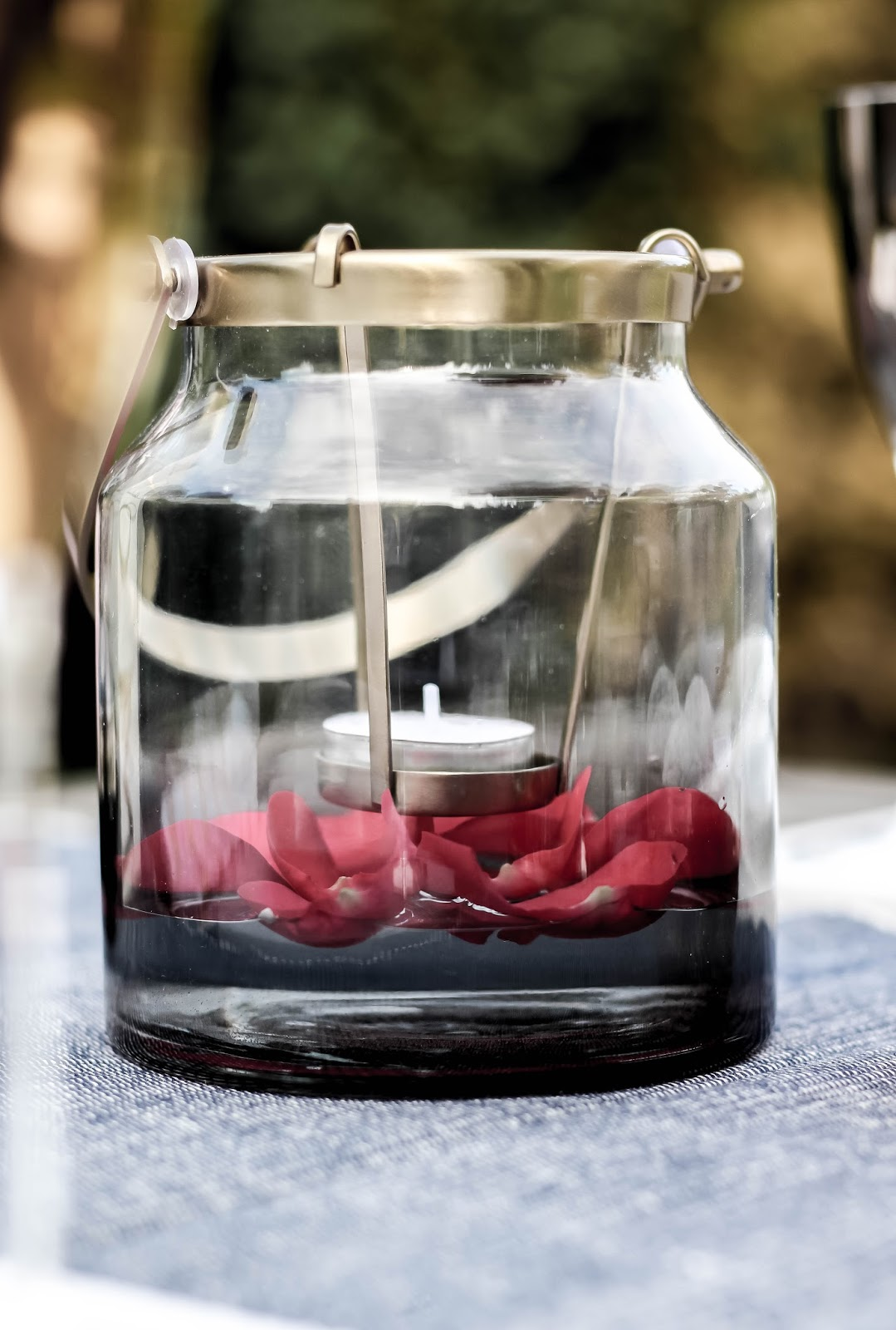 Gold Glass Jar Petals Floating in Water