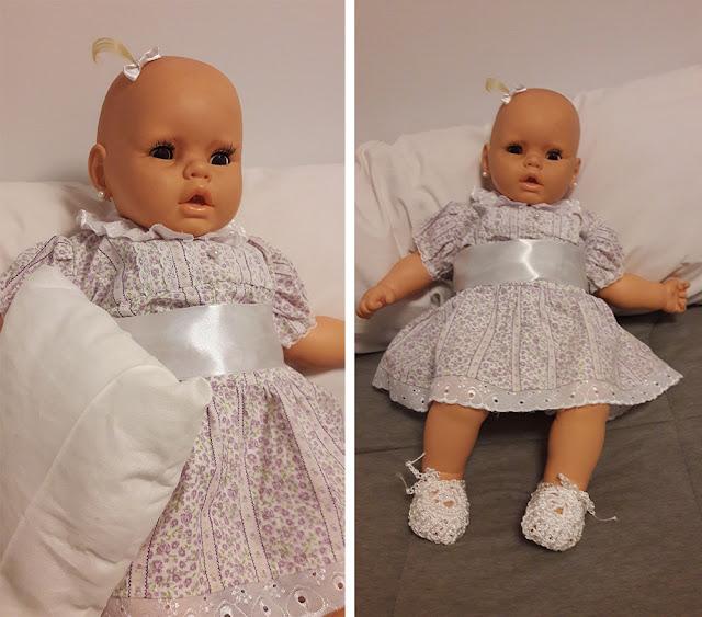 boneca consertada e vestida