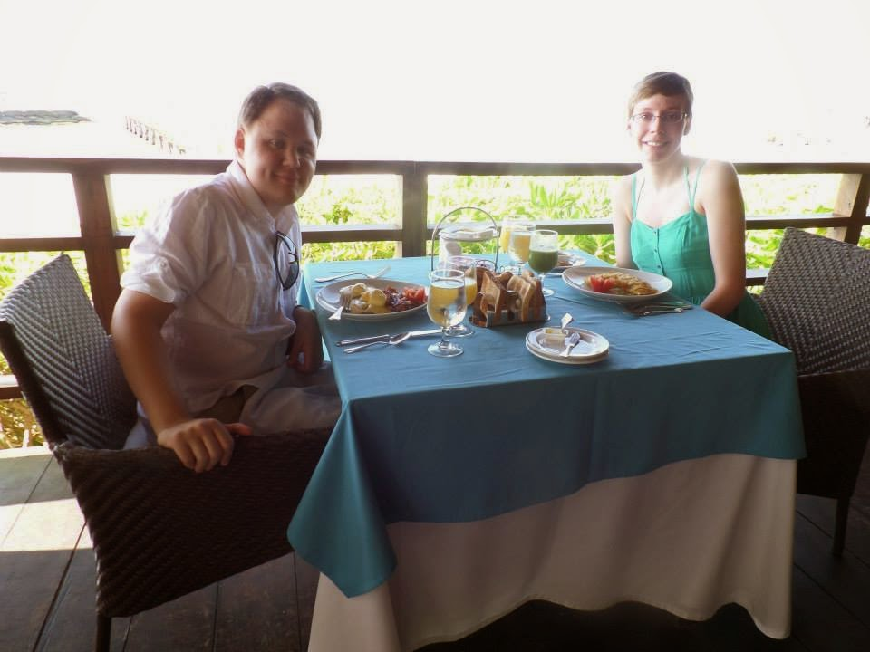 Photo of my wife and I about to eat a delicious breakfast near the ocean.