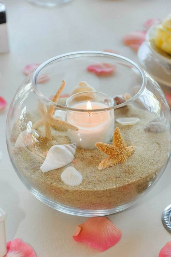 beached theme wedding bowl, crystal fish bowl masterpiece decoration with candle in the center and rose petals around, beach themed ornament for decoration