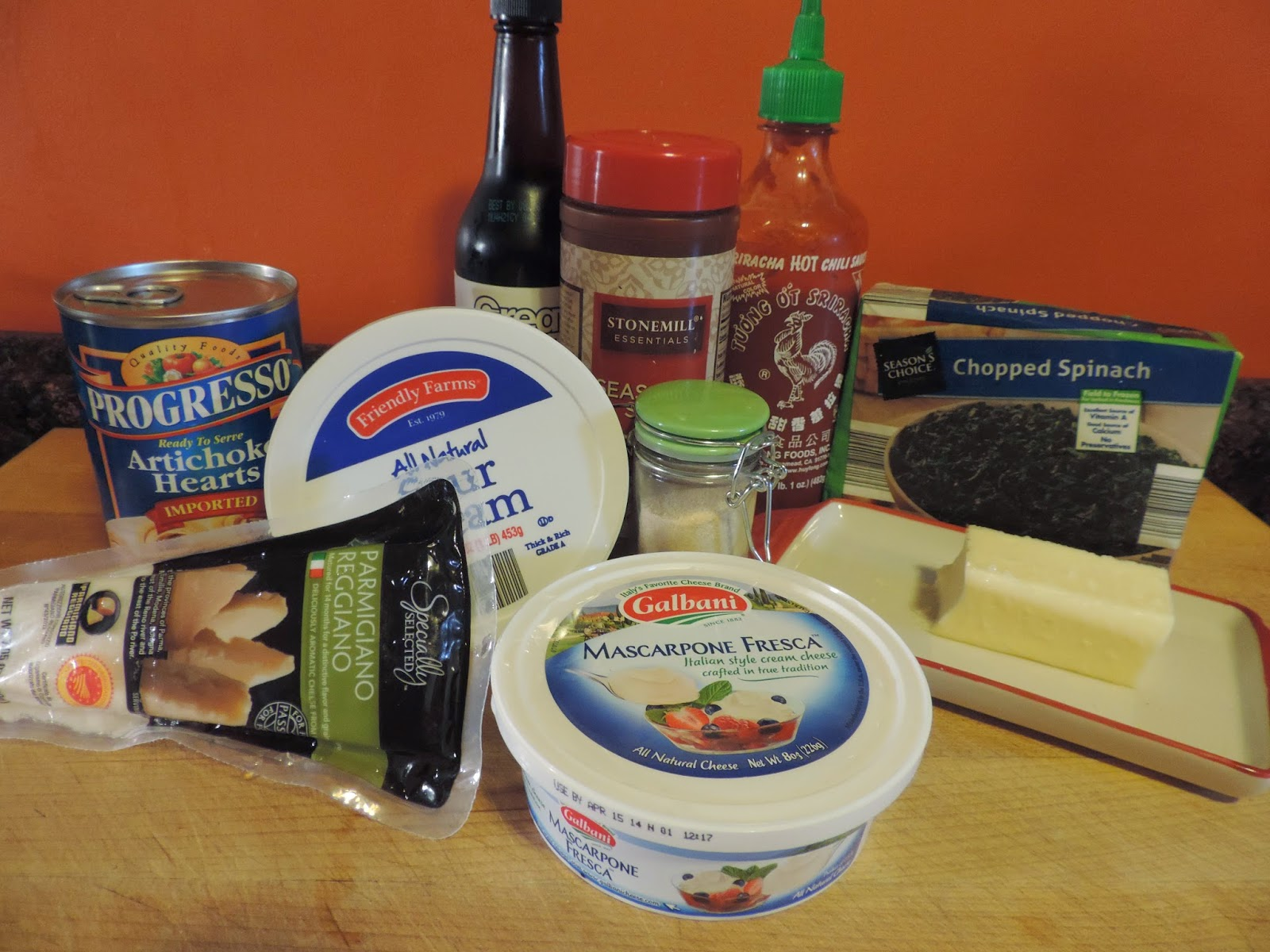 The ingredients needed to make the Baked Spinach Artichoke Dip.