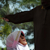 Woman flogged 7 times for standing too close to man in Aceh, Indonesia