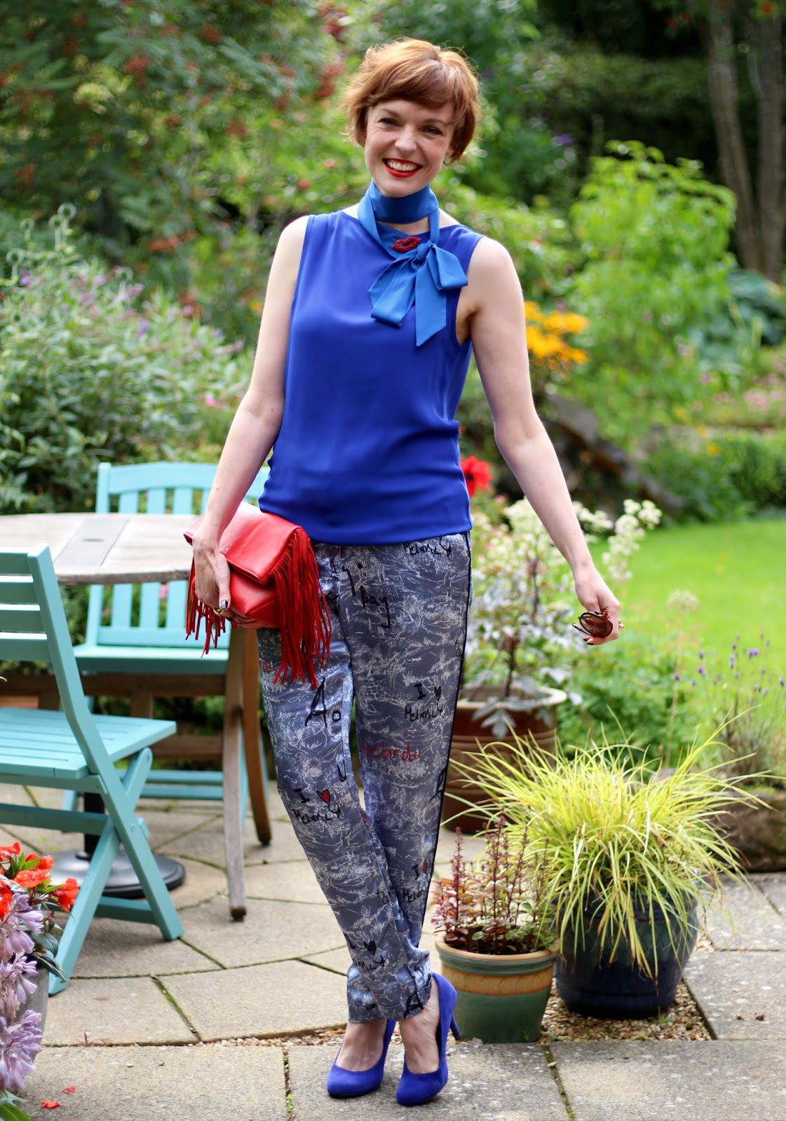 Fake Fabulous | Cobalt blue top worn back to front, pyjama trousers, red lips and blue heels.